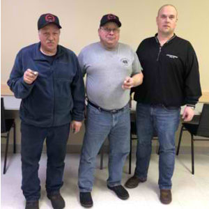 (left) Robert and Rick Luukkonen standing with Local 49 Business Agent Dan Snidarich who presented them with their 40 year service pin
